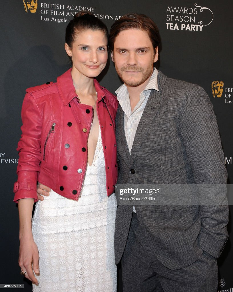 Daniel Bruhl (R) and Felicitas Rombold attend the BAFTA LA 2014 Awards Season Tea Party at Four Seasons Hotel Los Angeles in Beverly Hills on January 11, 2014 in Beverly Hills, California.