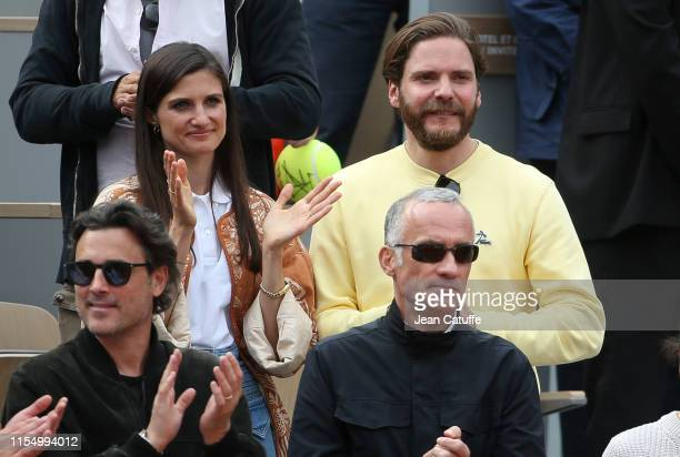 Daniel Bruhl and girlfriend Felicitas Rombold attends the men's final between Rafael Nadal of Spain and Dominic Thiem of Austria during day 15 of the...