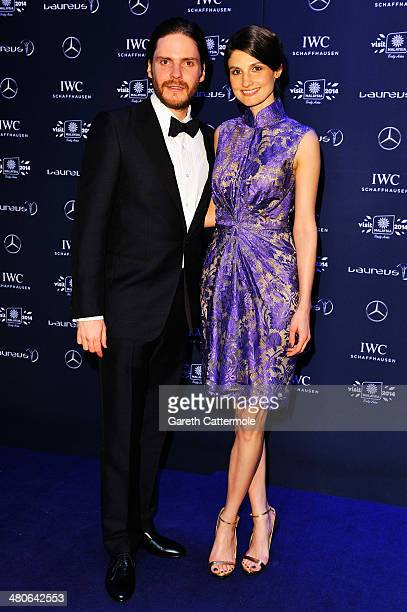 Daniel Bruhl and guest attend the 2014 Laureus World Sports Awards at the Istana Budaya Theatre on March 26 2014 in Kuala Lumpur Malaysia