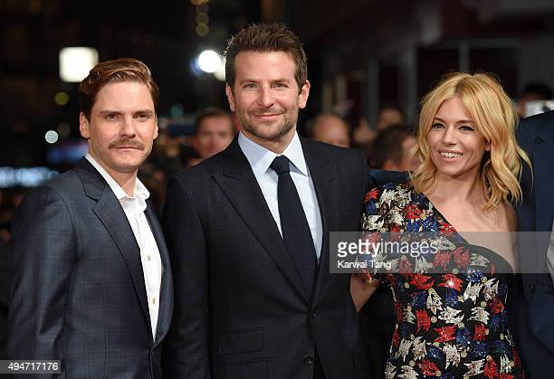 Daniel Bruhl, Bradley Cooper and Sienna Miller attend the UK Film Premiere of 'Burnt' at Vue West End on October 28, 2015 in London, England.