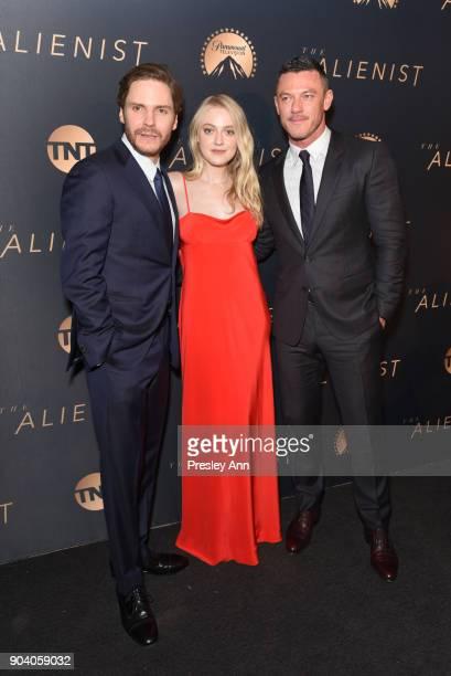 Daniel Bruhl Dakota Fanning and Luke Evans attend Premiere Of TNT's 'The Alienist' Arrivals on January 11 2018 in Los Angeles California