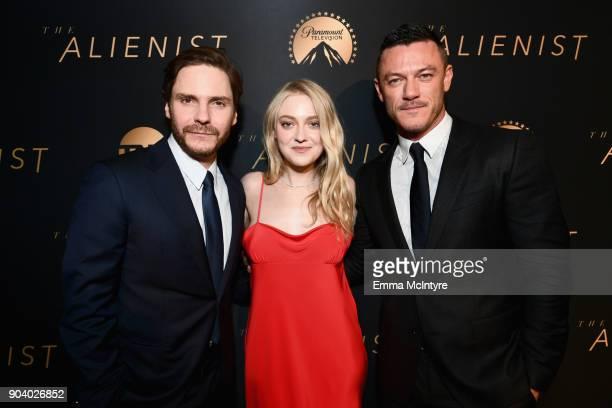 Daniel Bruhl Dakota Fanning and Luke Evans attend The Alienist LA Premiere Event at Paramount Studios on January 11 2018 in Hollywood California...