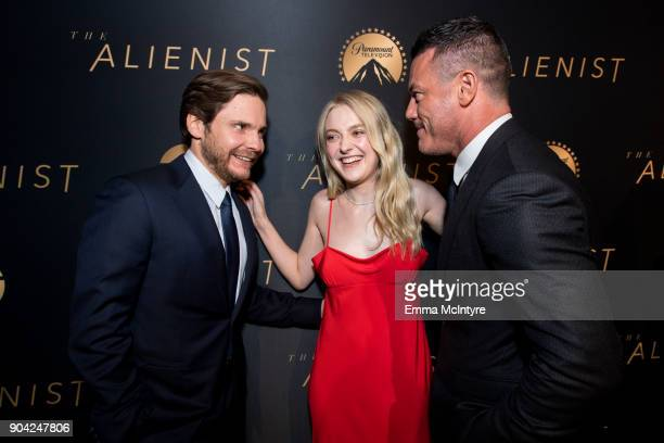 Daniel Bruhl Dakota Fanning and Luke Evans attend The Alienist LA Premiere Event at Paramount Studios on January 11 2018 in Hollywood California