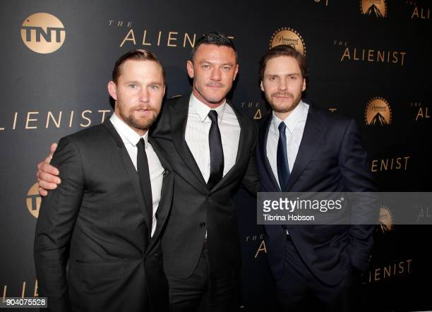 Daniel Bruhl Dakota Fanning and Luke Evans attend the premiere of TNT's 'The Alienist' on January 11 2018 in Los Angeles California