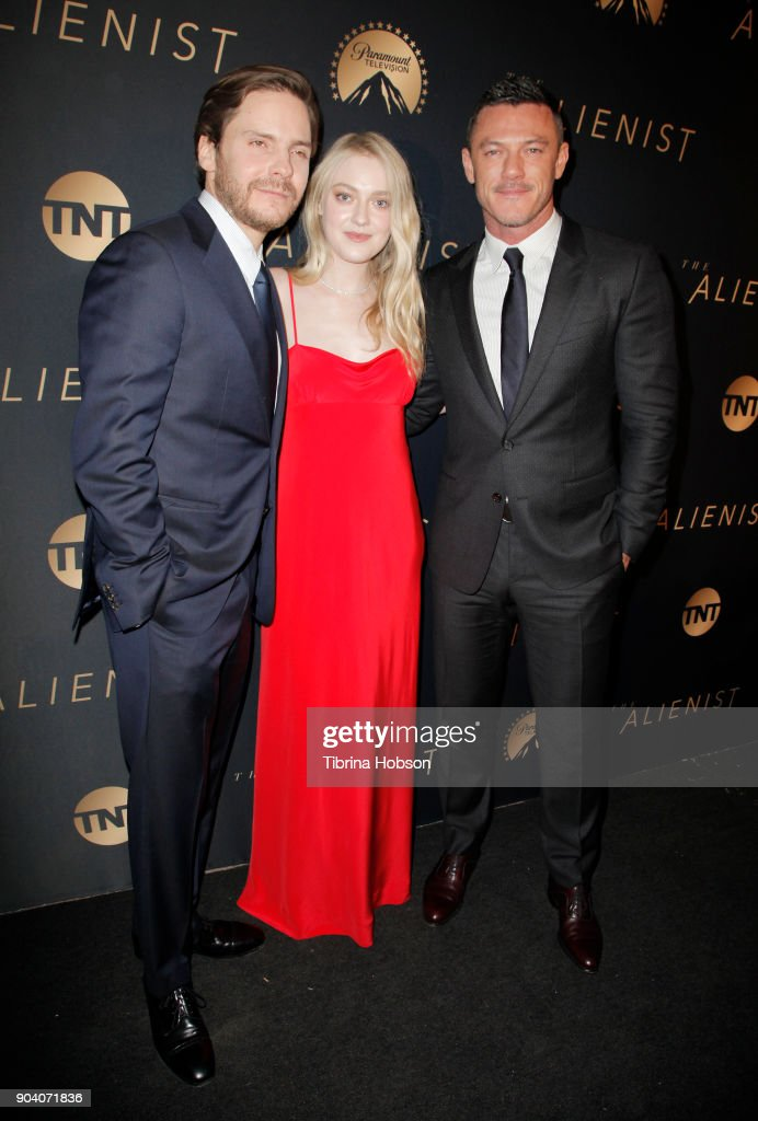 Daniel Bruhl, Dakota Fanning and Luke Evans attends the premiere of TNT's 'The Alienist' on January 11, 2018 in Los Angeles, California.