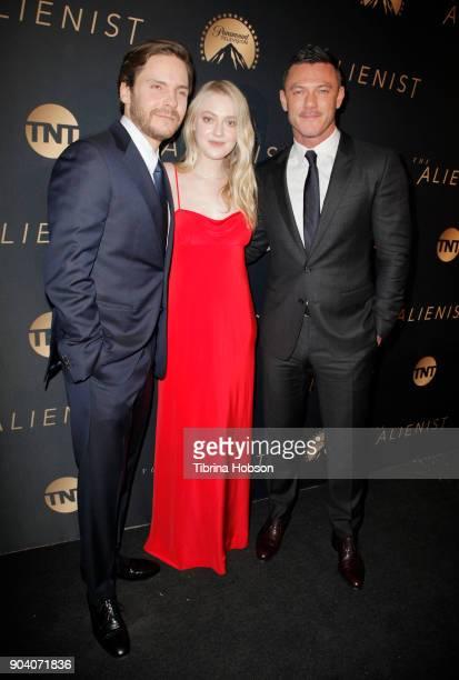 Daniel Bruhl Dakota Fanning and Luke Evans attends the premiere of TNT's 'The Alienist' on January 11 2018 in Los Angeles California