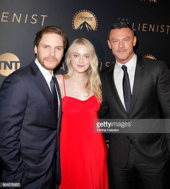 Daniel Bruhl Dakota Fanning and Luke Evans attends the premiere of TNT's 'The Alienist' on January 11 2018 in Los Angeles California