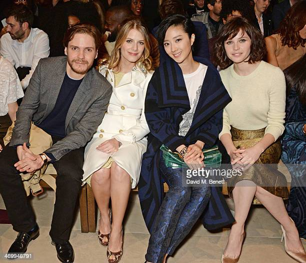 Daniel Bruhl Melanie Laurent Guey LunMei and Felicity Jones attend the front row at Burberry Womenswear Autumn/Winter 2014 at Kensington Gardens on...