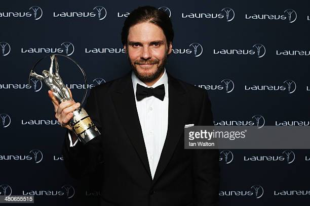 Daniel Bruhl poses with the Laureus trophy during the 2014 Laureus World Sports Awards at the Istana Budaya Theatre on March 26 2014 in Kuala Lumpur...