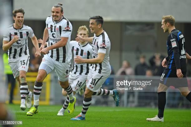 Daniel Buballa Alexander Meier Mats Moeller Daehli and Ersin Zehir of Sankt Pauli celebrate while Ben Zolinski of Paderborn looks dejected during the...