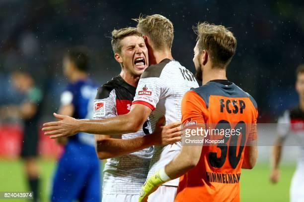 Daniel Buballa JanPhilipp Kalla and Robin Himmelmann of St Pauli celebrate after winning the Second Bundesliga match between VfL Bochum 1848 and FC...