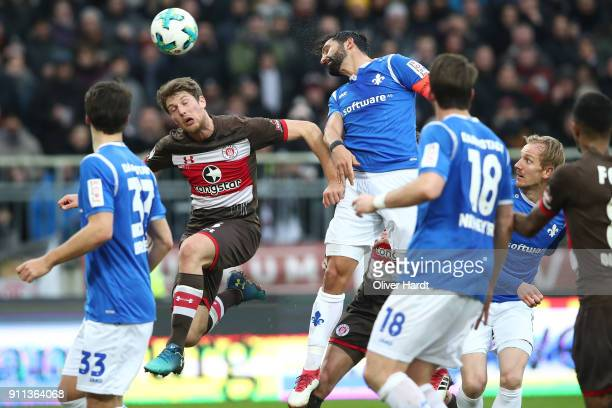Daniel Buballa of Pauli and Aytac Sulu of Darmstadt compete for the ball during the Second Bundesliga match between FC St Pauli and SV Darmstadt 98...