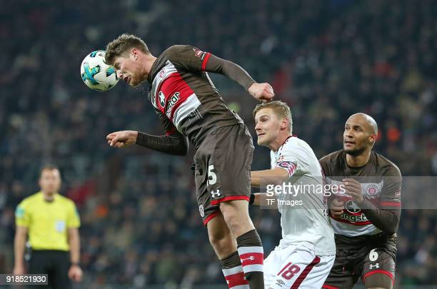 Daniel Buballa of St Pauli and Hanno Behrens of Nuernberg and Christopher Avevor of St Pauli battle for the ball during the Second Bundesliga match...