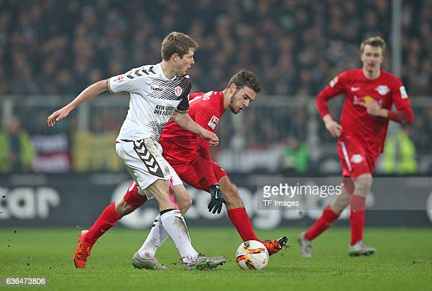 Daniel Buballa of St Pauli and Massimo Bruno of RB Leipzig battle for the ball during the Second Bundesliga match between FC St Pauli and...