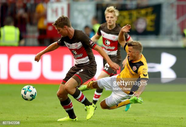 Daniel Buballa of St Pauli and Patrick Moeschl of Dresden battlle for the ball during the Second Bundesliga match between FC St Pauli and SG Dynamo...