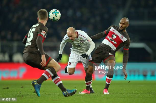 Daniel Buballa of St Pauli and Tobias Werner of Nuernberg and Christopher Avevor of St Pauli battle for the ball during the Second Bundesliga match...