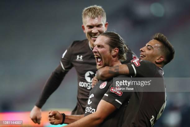 Daniel Buballa of St Pauli celebrates with teammate Rodrigo Zalazar after scoring his team's second goal during the Second Bundesliga match between...