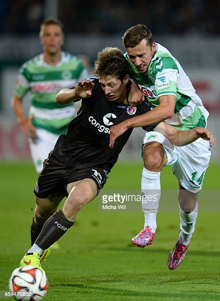 Daniel Buballa of St.Pauli and Tom Weilandt of Fuerth compete for the ball during the Second Bundesliga match between Greuther Fuerth and FC St....