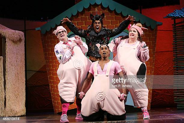 Daniel Buckley Simon Webbe Taofique Folarin and Leanne Jones perform on stage during a photocall for The Three Little Pigs at Palace Theatre on...