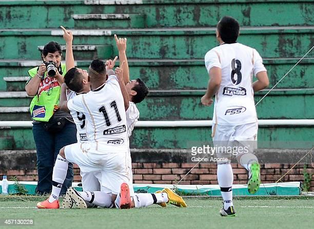 Daniel Buitrago of Llaneros FC celebrates with his teammates after scoring a last-minute goal during a match between America de Cali and Llaneros FC...