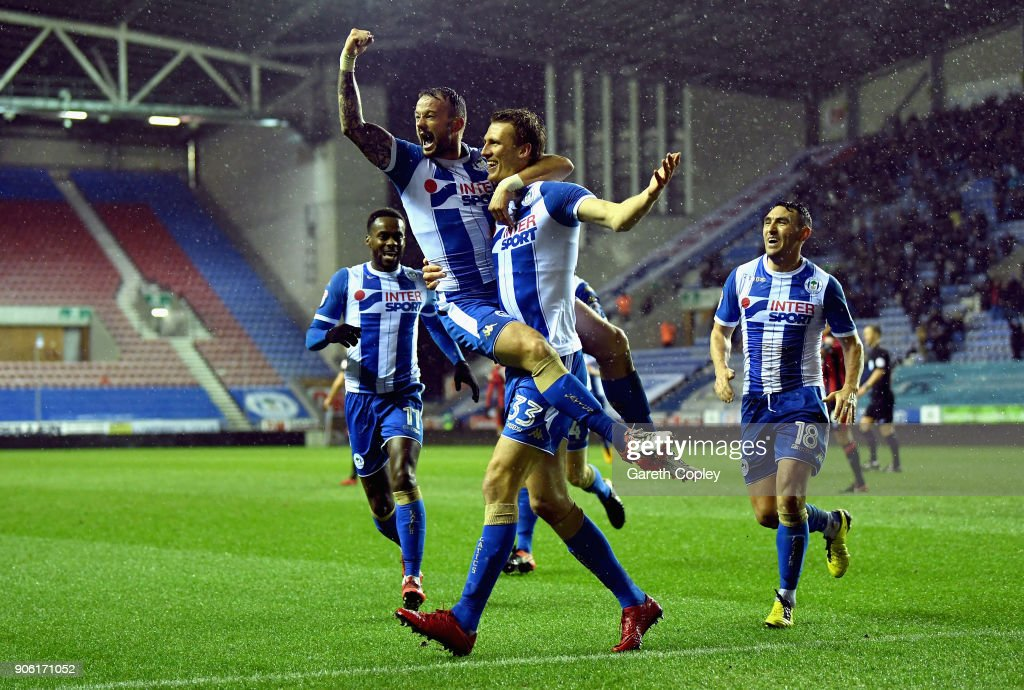 Daniel Burn of Wigan celebrates with team mates after scoring his side second goal during The Emirates FA Cup Third Round Replay between Wigan and AFC Bournemouth at DW Stadium on January 17, 2018 in Wigan, England.