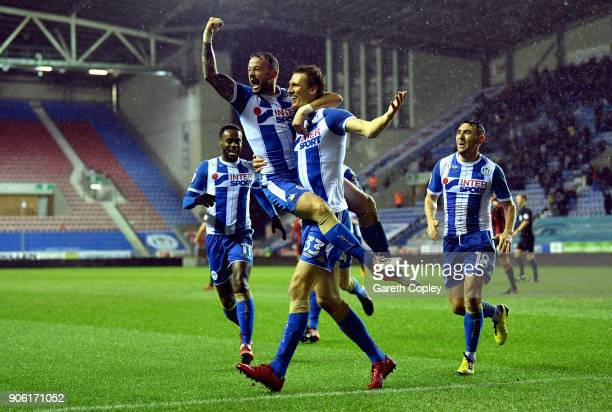 Daniel Burn of Wigan celebrates with team mates after scoring his side second goal during The Emirates FA Cup Third Round Replay between Wigan and...