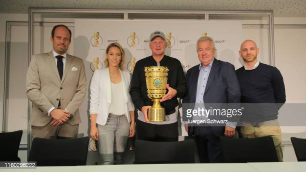 Daniel Busse, Laura Papendick, Stefan Effenberg, Peter Frymuth and Nikolas Weinhart attend a news conference prior to the upcoming DFB cup match...