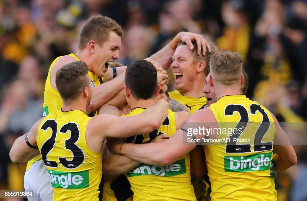 Daniel Butler of the Tigers celebrates after kicking a goal with Jack Riewoldt of the Tigers during the 2017 AFL Grand Final match between the...