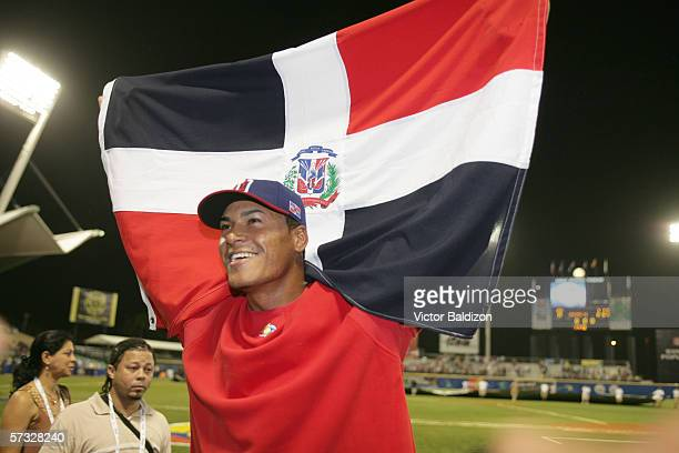 Daniel Cabrera of the Dominican Republic is pictured with a flag from his country after the game against Venezuela on March 14 2006 at Hiram Bithorn...