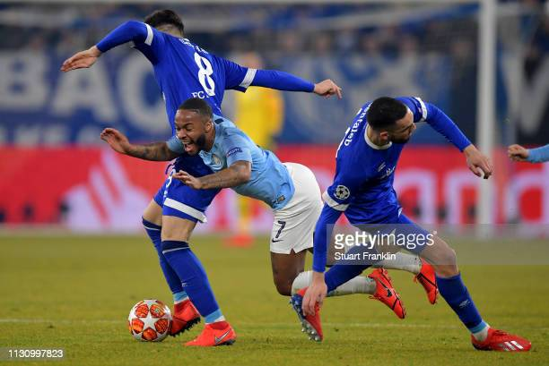 Daniel Caligiuri and Nabil Bentaleb of Schalke challenges Raheem Sterling of Manchester City during the UEFA Champions League Round of 16 First Leg...