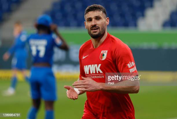 Daniel Caligiuri of Augsburg celebrates his team's first goal during the Bundesliga match between TSG Hoffenheim and FC Augsburg at PreZero-Arena on...