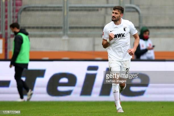Daniel Caligiuri of FC Augsburg celebrates after scoring his team's second goal during the 1. Bundesliga match between FC Augsburg and Borussia...