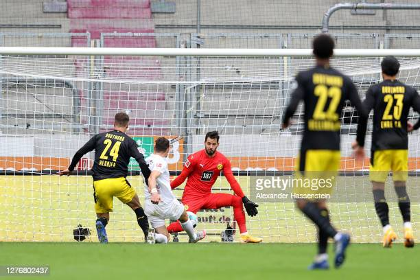 Daniel Caligiuri of FC Augsburg scores his sides second goal during the Bundesliga match between FC Augsburg and Borussia Dortmund at WWK-Arena on...