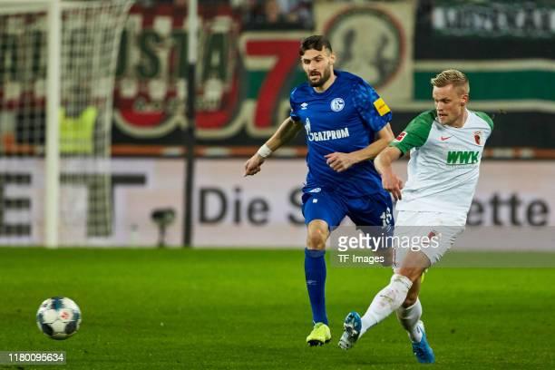 Daniel Caligiuri of FC Schalke 04 and Philipp Max of FC Augsburg battle for the ball during the Bundesliga match between FC Augsburg and FC Schalke...