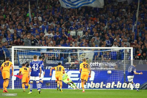 Daniel Caligiuri of FC Schalke 04 scores his sides first goal from the penalty spot during the Bundesliga match between FC Schalke 04 and TSG 1899...