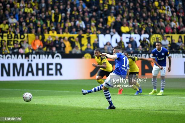 Daniel Caligiuri of FC Schalke 04 scores his team's first goal from a penalty during the Bundesliga match between Borussia Dortmund and FC Schalke 04...