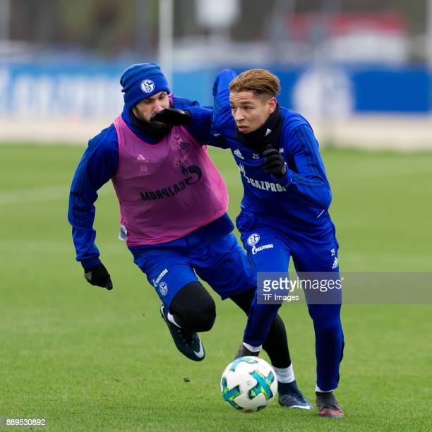 Daniel Caligiuri of Schalke and Amine Harit of Schalke battle for the ball during a training session at the FC Schalke 04 Training center on December...