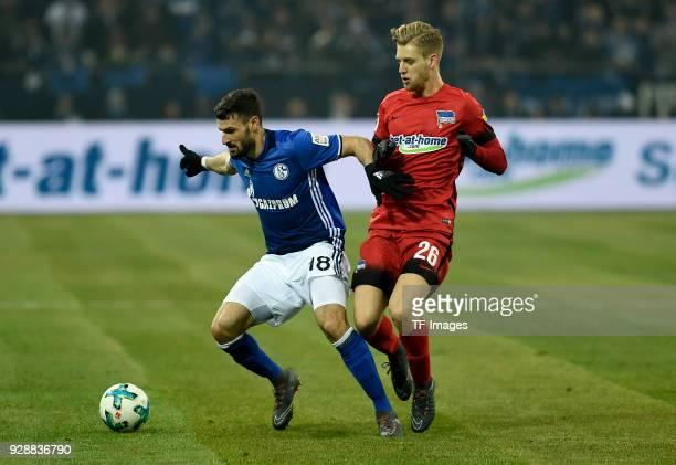 Daniel Caligiuri of Schalke and Arne Maier of Hertha battle for the ball during the Bundesliga match between FC Schalke 04 and Hertha BSC at...
