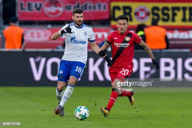 Daniel Caligiuri of Schalke and Charles Aranguiz of Leverkusen battle for the ball during the Bundesliga match between Bayer 04 Leverkusen and FC...