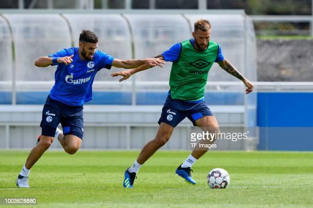 Daniel Caligiuri of Schalke and Guido Burgstaller of Schalke battle for the ball during a training session at the FC Schalke 04 Training center on...