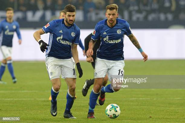 Daniel Caligiuri of Schalke and Guido Burgstaller of Schalke in action during the Bundesliga match between FC Schalke 04 and 1 FC Koeln Bundesliga at...