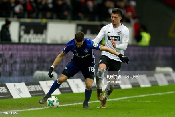 Daniel Caligiuri of Schalke and Luka Jovic of Frankfurt battle for the ball during the Bundesliga match between Eintracht Frankfurt and FC Schalke 04...