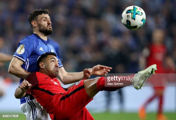 Daniel Caligiuri of Schalke and Marco Fabian of Frankfurt battle for the ball during the Bundesliga match between FC Schalke 04 and Eintracht...