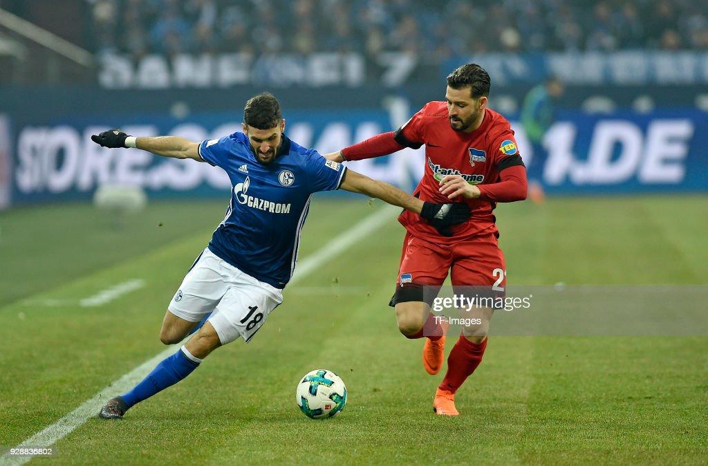 Daniel Caligiuri of Schalke and Marvin Plattenhardt of Hertha battle for the ball during the Bundesliga match between FC Schalke 04 and Hertha BSC at Veltins-Arena on March 03, 2018 in Gelsenkirchen, Germany.