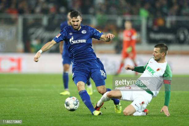 Daniel Caligiuri of Schalke battles for the ball with Daniel Baier of Augsburg during the Bundesliga match between FC Augsburg and FC Schalke 04 at...