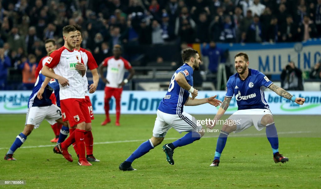 Daniel Caligiuri of Schalke celebrates after he scores the 2nd goal by penalty during the Bundesliga match between FC Schalke 04 and FC Augsburg at Veltins-Arena on December 13, 2017 in Gelsenkirchen, Germany.