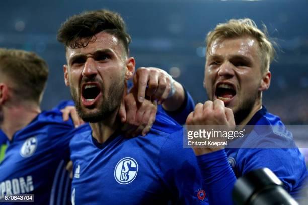 Daniel Caligiuri of Schalke celebrates the third goal with Johannes Geis during the UEFA Europa League quarter final second leg match between FC...