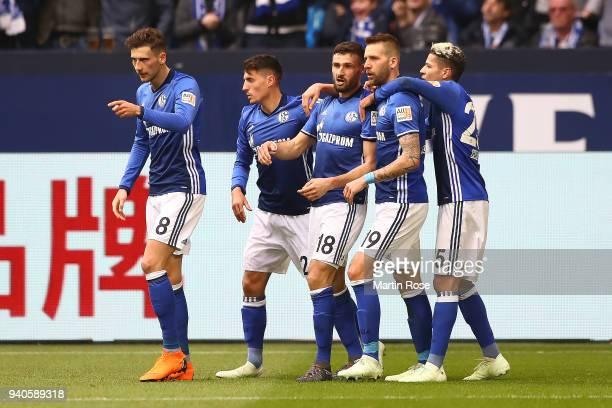 Daniel Caligiuri of Schalke celebrates with his team after he scored a penalty goal to make it 10 during the Bundesliga match between FC Schalke 04...