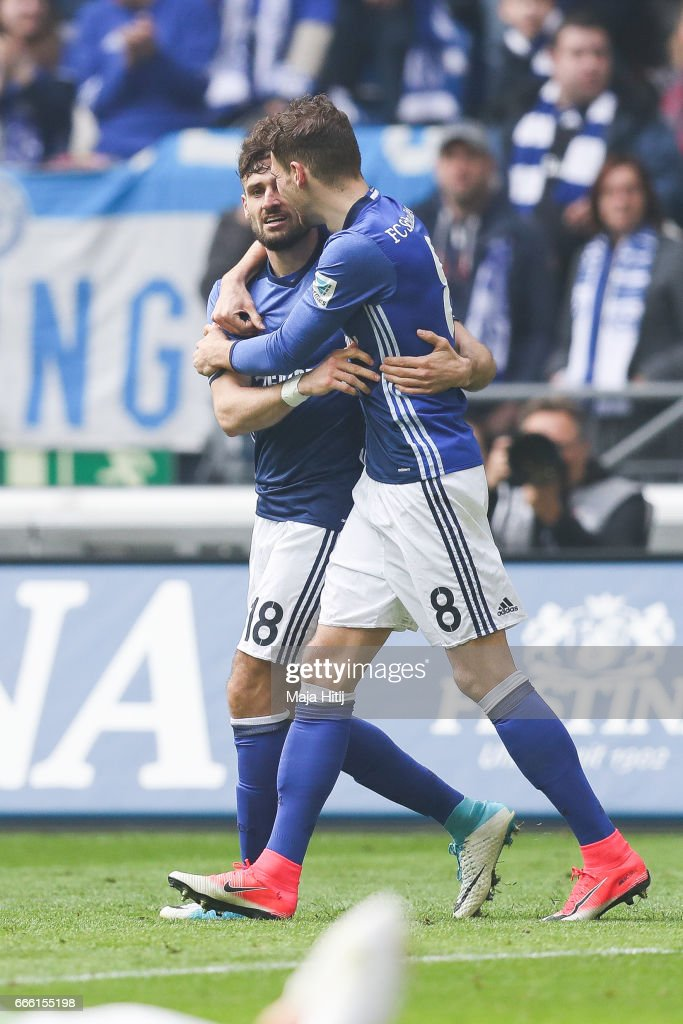 Daniel Caligiuri of Schalke #18 celebrates with Leon Goretzka after scoring a goal to make it 2-0 during the Bundesliga match between FC Schalke 04 and VfL Wolfsburg at Veltins-Arena on April 8, 2017 in Gelsenkirchen, Germany.