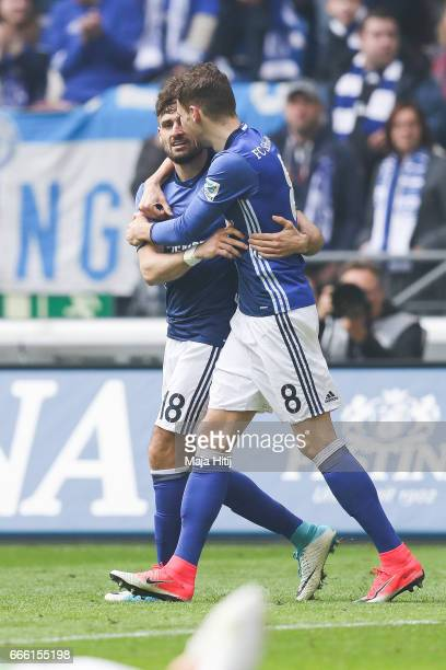 Daniel Caligiuri of Schalke celebrates with Leon Goretzka after scoring a goal to make it 20 during the Bundesliga match between FC Schalke 04 and...